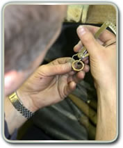 image of jeweller looking at detail.